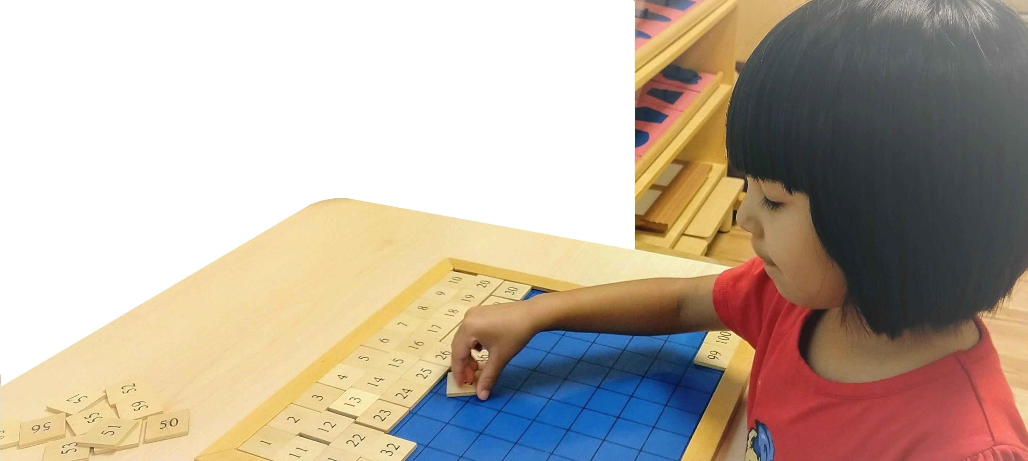Child doing Montessori work